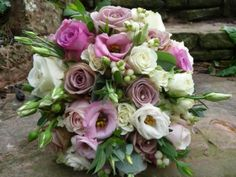 amnesia roses, dusky pink lisiantus, spray cream roses (and snowberries- i don't want these)