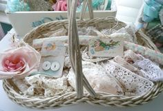 A painted wicker basket is a great way to display vintage sewing trims, buttons, fabric and other vintage treasures.