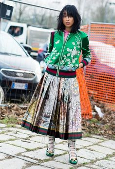 Margaret Zhang in a green embroidered Gucci bomber jacket and pleated metallic skirt. Fashion 101, Work Fashion, Fashion Trends, Skirt Fashion, Metallic Pleated Skirt, Evolution Of Fashion, Feminine Style, Casual Wear, Trending Outfits