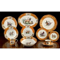 The bright colors of America's wildlife on fine porcelain tableware. Designed and decorated in America. Chestnut rims are adorned with gold-accented oak leaves and acorns.