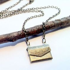 Pocketbook Necklace  by Ideology