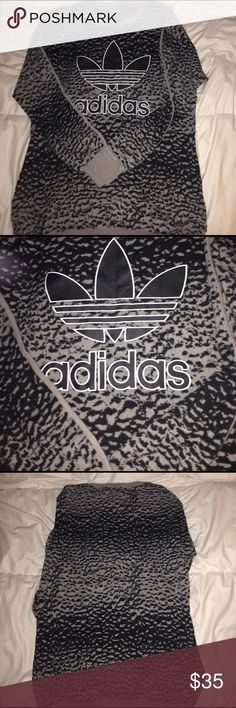 Adidas Black &Grey Cheetah Print Crew Neck It's has like a black and grey cheetah type print with the Adidas logo on the front chest area . Adidas Sweaters Crew & Scoop Necks