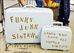 old suitcases used for a sign