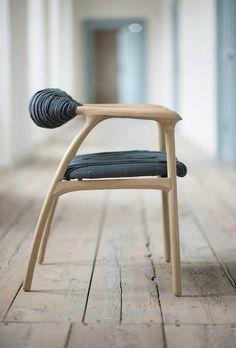 haptic chair Un profil original , jolie forme, dossier atypique