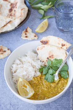Vegan Red lentil dal - served with steaming rice and naan bread this vegan dahl is the ultimate in comfort food | DeliciousEveryday.com