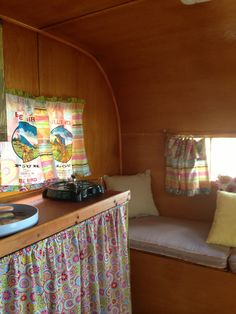 Pretty cabinets in vintage trailer. Interior of Sweet Charity
