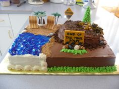 End of the Trail - This is a retirement cake that I did for a man who had run a grater for the city for 35 yrs.  He loved the beach & was heading for it after retirement!  Everything on the cake was eatable except  for the grater & the lollipop sticks that held up the sign.  Time consuming but fun to make!  Thanks for looking.