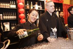 Pouring at the sake bar for eager customers