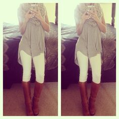 White pants, long sheer tunic, riding boots and infinity scarf.
