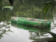 600ml bottles used are glued together to a layer of foam underneath to create this boat.
