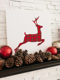 Need more pattern in your holiday decor? Make this DIY plaid reindeer artwork from our free downloadable stencil >> http://www.diynetwork.com/how-to/make-and-decorate/entertaining/how-to-make-plaid-christmas-reindeer-artwork?soc=pinterest