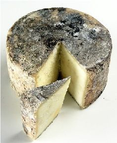 Gamonedo quesode Astúrias  Spain. It is a lightly smoked cheese with a thin, natural rind that is coloured brownish with some red, green and blue patches. Moulds on the rind slightly invade the interior of the cheese. Gamonéu cheese is sold in the form of cylinders with flat ends in weights varying between 500g (18 oz) to 7 kg (15 lbs)