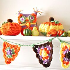 Crochet a fall mantel-scape with these free crochet patterns for pumpkins, and owl, and a bunting.