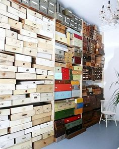You probably couldn't store anything in these drawers, with fear of them avalanching towards you, but makes for very quirky wall art