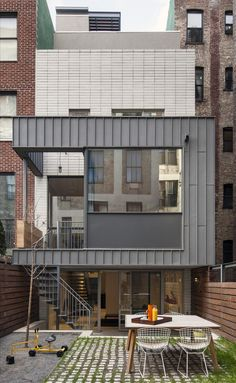 Built by Ben Hansen Architect in New York, United States with date 2012. Images by Francisc Dzikowski Photography Inc.. In many ways, the historic New York City townhouse is not compatible with a contemporary family's way of life.  The f...
