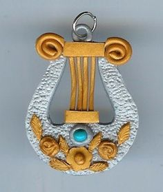 Silver and Gold Lyre Pendant.