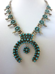 Fabulous Vintage Zuni Sterling Silver & Petit Point Turquoise Squash Blossom Necklace. Lively Swinging Flower pendant in the Naja. Gorgeous. $425.00.