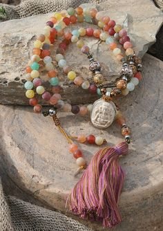 Mala made of 108, 8 mm - 0.315 inch, beautiful frosted agate gemstones and decorated with jasper, hematite, silver- and bronze colored beads and a Nepalese Ganesha pendant. The mala features a detachable tassel - look4treasures on Etsy