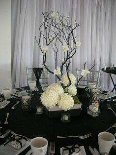 The branch would be silver.. hydrangea and a touch of red gladiola blooms at base, white orchids on branches