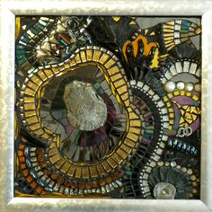 """Around My Pyrite (2008) by Line Dauvergne of Caen, France   Materials: stained glass, glitter tiles, colored mirror, peacock ore, smalti, tapestry glass, beads, shells, ice jade, bismuth, chalcedony and rhinestones. framed   Dimensions: 15"""" x 15"""""""