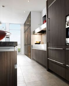 Dark wood and flat panel design create a modern look in this Wood-Mode kitchen  http://www.KNSales.com/Cabinetry/?Term=250