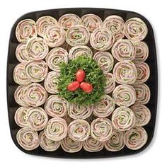 Party Pinwheels: I made these with 2 cans of deviled ham, softened cream cheese, onion and garlic powder and worstershire sauce and chopped spinach. Whipped that until creamy, spread it on large burrito shell and put a slice of honey ham on each. Rolled them up and tried to slice evenly. Stacked them up like above. Very good and pretty.