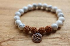 Howlite and Rudraksha Mala Bracelet with a Lotus Pendant