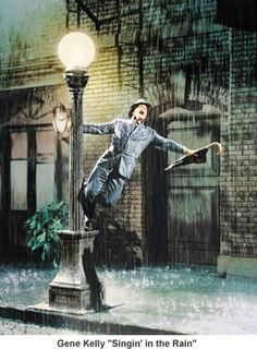 """This has always been one of my favorite promo shots of all time. """"Just singin'...and dancin' in the rain..."""""""