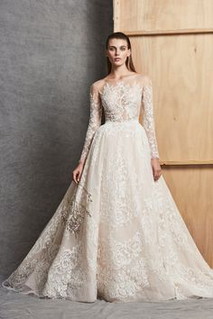 Long sleeved ballgown with Illusion neckline and detachable skirt. | Zuhair Murad| Style #CARMINA #ballgown #zuhairmurad #detachableskirt #longsleeve
