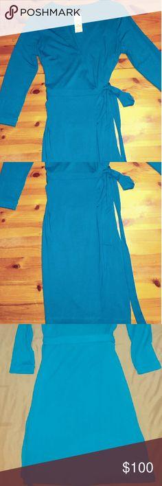 Pice drop $50 Beautiful Blue Ann Taylor Dress Beautiful blue Ann Taylor  Wrap Dress. 98% Rayon Rayonne / 7% Spandex. Ann Taylor Dresses Long Sleeve