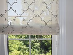 sheer pattern roman shade. Simple and chic.