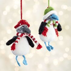 Blue-footed booby birds ward off winter's chill with cozy hats and striped mufflers.  Hand-knit exclusively for Crate and Barrel by women in Peru, this ornament was created with an organization whose stated mission is to empower artisans to earn a sustainable income to provide their families food, shelter and healthcare. HandcraftedAlpaca, wool and polyesterMade in Peru.