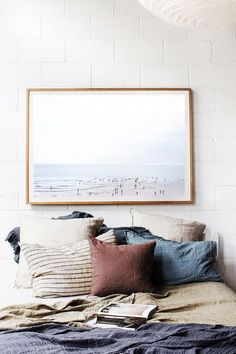 Bedroom inspiration - Lots of neutral pillows, minimalist artwork, and blankets