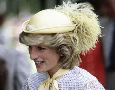 Pin for Later: We're Tipping Our Hats to Princess Diana's Timeless Toppers Mellow Yellow The Princess of Wales topped her Summerside ensemble with a pastel yellow plumed hat in June 1983.