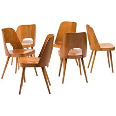 Set of Six Bentwood Chairs by Oswald Haerdtl for Thonet | From a unique collection of antique and modern dining room chairs at https://www.1stdibs.com/furniture/seating/dining-room-chairs/