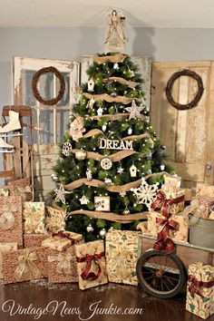 Vintage Rustic Christmas Tree Decor. Would match our living area much better this year! Can't wait!