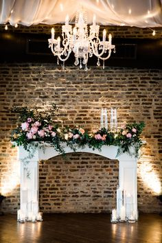 Wedding alter alternatives, chandelier, fireplace mantle, exposed brick wall, candles // Nyk + Cali