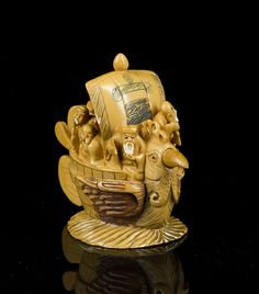 """Antique Netsuke, """"Sokyu"""", mid 18thC., carver, seven Gods in a boat with base, 2 3/8""""T x 2 7/8""""W, minor rub on sail, good condition, polychrome decoration, Ivory."""