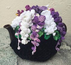 Olenas Tea cozies and Crafts are each individually make to order. No assembly line, no manufacturing process. Just a unique design, made like no other My model tea pot (I brought it from Ukraine) is for 3 cups. However I now make a tea cozy for every shape and size. For the base I use a special bulky Chenille Velvet yarn, which I order from the factory in Turkey. For flowers and leaves, I use only 100% cotton thread. To make them look more real, I use variegated colors. Most of this type of…