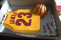 Lebron James Cavaliers Jersey cake. Half chocolate, half vanilla cake with buttercream icing and wilton candy melts for the name and number. Rice krispie basketball covered in fondant.