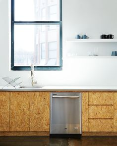 Custom chipboard kitchen cabinets in the Brad-Sherman-designed office-kitchen-for-mobile-commons-James-Ransom-photo | Remodelista