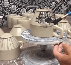 In this video, we see Julia Claire of JuliaClaireClay showing us how to mishima a mug using wax resist on leather hard pots. Check out this video.