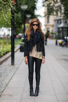 Combo of leather biker jacket, loose top and black leather troursers will always look good