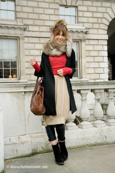a lot going on and i love every bit. bubble hem, fur scarf, giant bag, pop of color, lovely boots