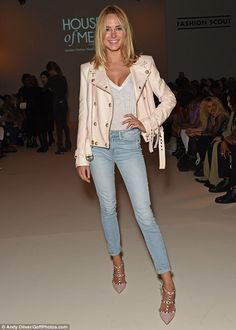 Chic: Kimberley Garner showed off her killer physique in denim jeans and a white t-shirt a...