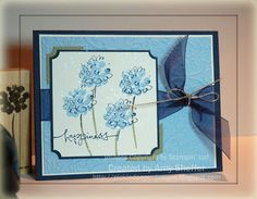 "Stamps: Heartfelt Thanks, Warm Words, Itty Bitty Backgrounds Paper: Whisper White, Night of Navy, Mellow Moss, Bashful Blue Inks: Bashful Blue, Mellow Moss, Night of Navy, Encore Silver Metallic Accessories: ticket corner punch, photo corner punch, navy wide organdy ribbon, silver cord, Cuttlebug ""textile"" embossing folder"