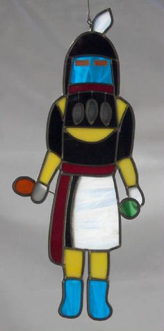 Angak'china, the Long-Haired Kachina, is a bringer of gentle rains and flowers. He is the Kokokshi of Zuni
