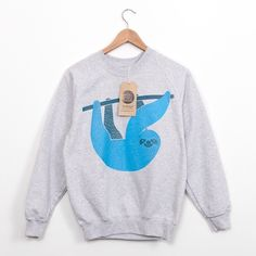 A colorful illustration on a comfy sweatshirt. | 16 Sloth-Centric Wardrobe Ideas You Have To Own