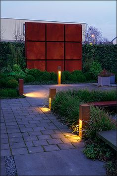 great way to use corten steel by making a grid with it...reducing unwieldy heavy sheets