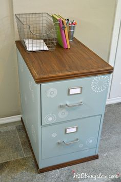 Use a thrift store cast off for this project. DIY tutorial for upcycled painted and stenciled filing cabinet makeover with stained wood top and bottom. Add style to your office a budget. H2OBunglow.com